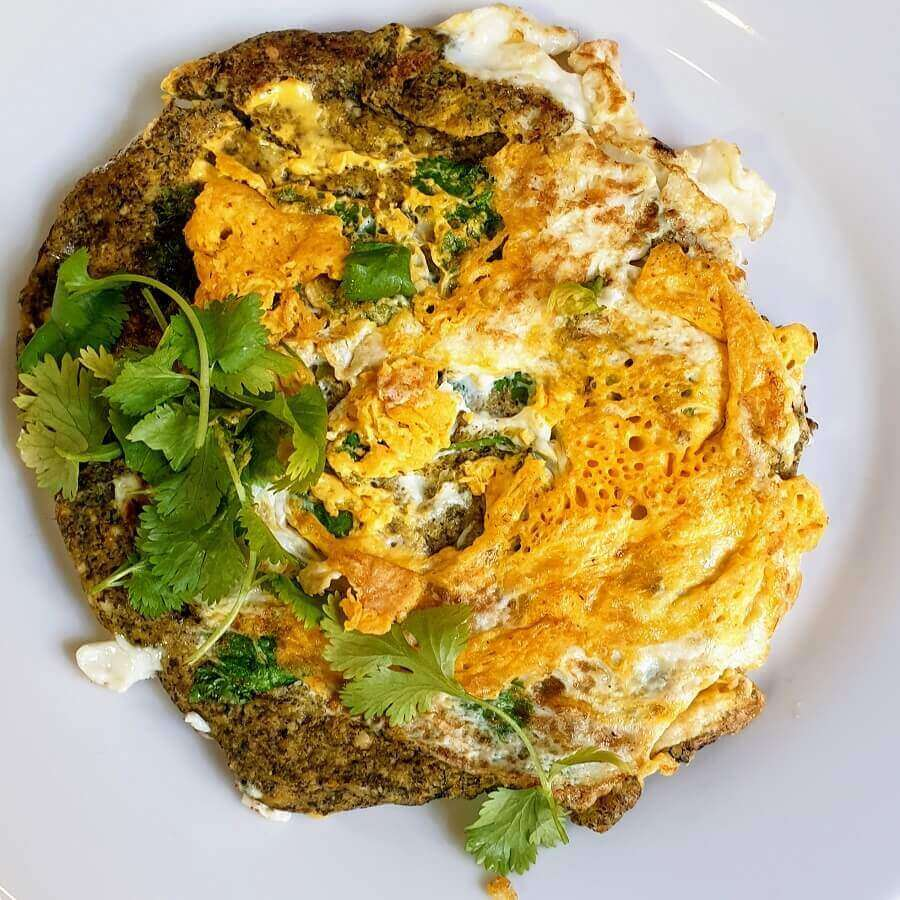 ... this one is made with coriander which I added just before I cracked the egg.  You can change the coriander  with chicken, spinach, chopped onions, shrimps or...  Bon Appetit