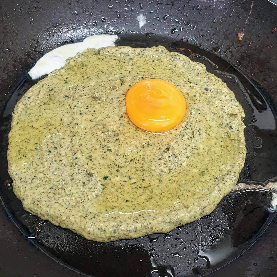 To get our breakfast bara - just add an egg on the pancake. It's edge should be 'high' enough to keep the egg from running out...